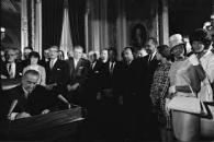 Johnson signs Voting rights act 1965